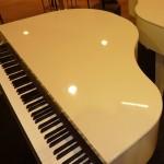 two white pianos